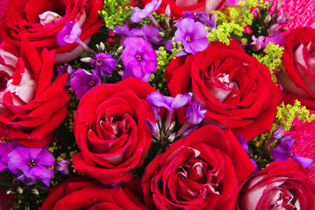 flowers : big bouquet of rose and pansy flowers with green grass in red wrapping papper Stock Photo - 9082480