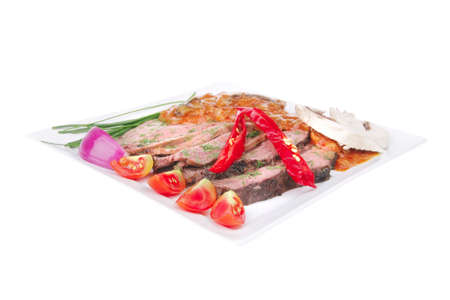 beef slice on white plate with peppers  Stock Photo - 9142763