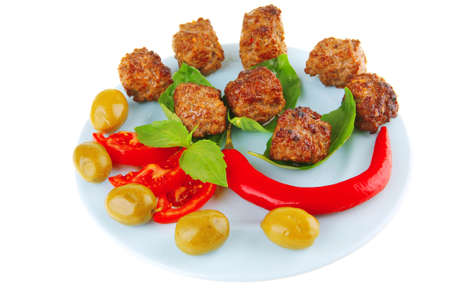 served meat cutlets with basil and tomatoes Stock Photo - 9173259