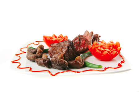 roast fillet mignon on a white ceramic plate with tomatoes Stock Photo - 9173200