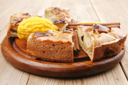 baked food : apple pie cuts on over table with cinnamon sticks and lemons Stock Photo - 9242300