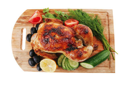 poultry : homemade roast turkey with greek olives and tomatoes on wooden board isolated over white background photo