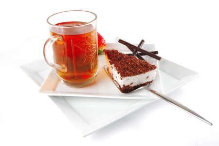milk cake and chocolate bars on white photo