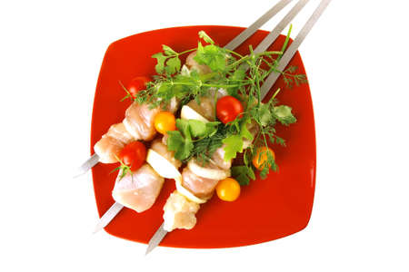 fresh chicken kebabs on red served with cherry photo