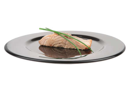 sea food : roasted pink salmon fillet with chinese onion, on black dish isolated over white background Stock Photo - 9335910