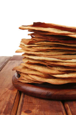 pile of hot baked cakes served on wooden plate Stock Photo - 9384758