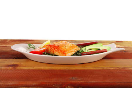 healthy food: hot baked salmon piece served over glass plate on wood Stock Photo - 9384776