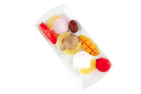 fresh tropical fruits and ice cream on white photo