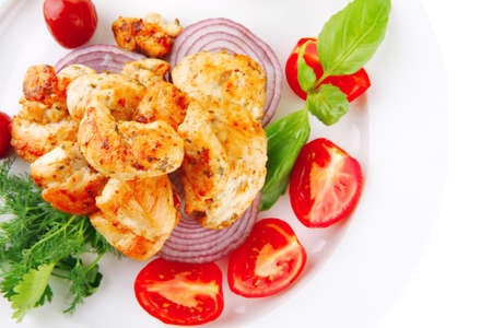 image of grilled chicken meat on white plate photo