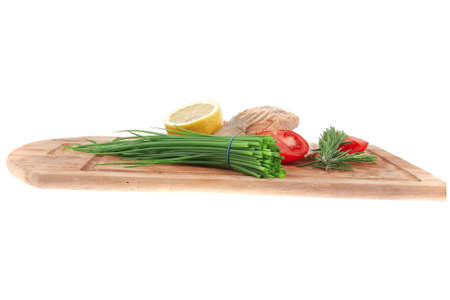 healthy fish cuisine : baked pink salmon steaks with green onion, cherry tomatoes, rosemary twigs and lemon on wooden board isolated on white background photo