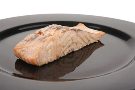sea food : roasted pink salmon fillet with chinese onion, on black dish isolated over white background Stock Photo - 9435057