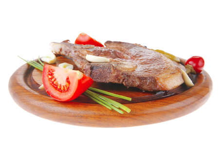 fresh hot roasted beef meat bone steak on red wooden plate with red hot pepper and capers isolated over white background Stock Photo - 9464254