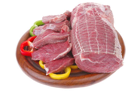 raw meat on wood over white background photo