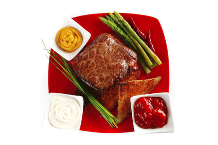 beef bbq on red with asparagus over white photo
