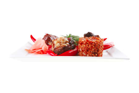 roast meat chunks on white  plate over white photo
