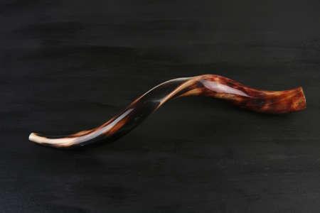 ram horn ( shofar ) isolated over black background