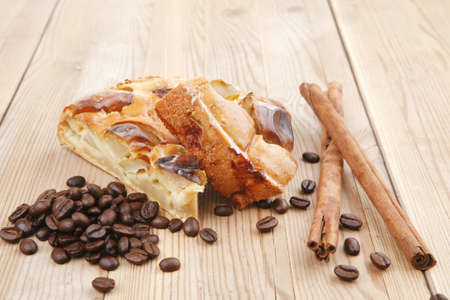 baked food : apple pies on wooden plate over table with cinnamon sticks and coffee beans photo