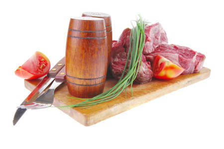 pepper castor: main course : fresh beef steak ready to prepare on cut board with cutlery and castor Stock Photo