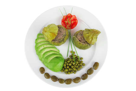 meat meal: round zucchini filled with mince meat over white dish photo