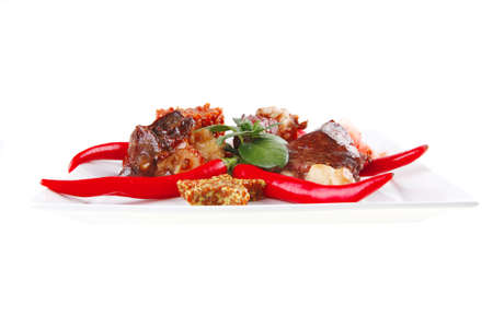 meat main course served on white plate over white Stock Photo - 9579551