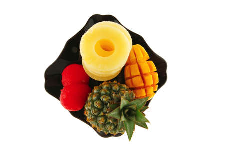 raw exotic fresh fruits served on black plate photo