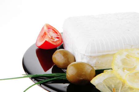 image of soft feta cheese on black plate Stock Photo - 9691698