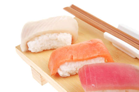 maguro: Japanese Cuisine - Set of Tuna (maguro) Salmon (sake) and Eel (unagi) Nigiri Sushi  with Wasabi on wooden plate isolated over white background