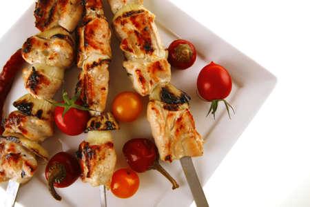 meat skewers: fresh grilled chicken shish kebab on white platter Stock Photo