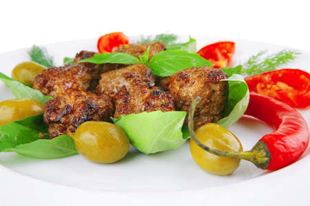meatballs and vegetables with basil and vegetables photo