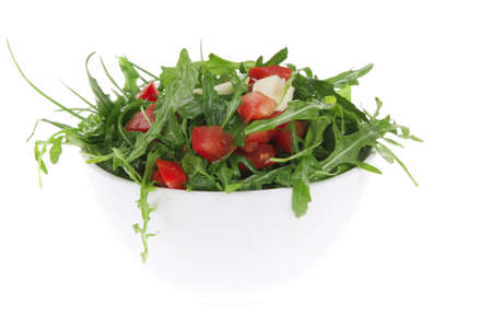 healthy appetizer : salad with raw tomato , garlic , and green staff in white bowl isolated over white background photo