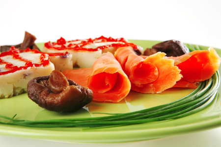 pink smoked salmon with mashed potatoes served on green photo