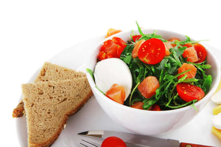 green salad with smoked salmon and bread in white bowl Stock Photo - 9776704