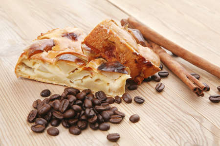 sweet food : apple pie on wooden plate with cinnamon and coffee beans photo
