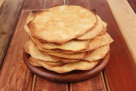 pile of hot baked cakes served on wooden plate Stock Photo - 9798823