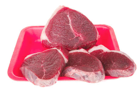 raw meat : fresh beef pork big tenderloin strip on red tray isolated over white background Stock Photo - 9821397
