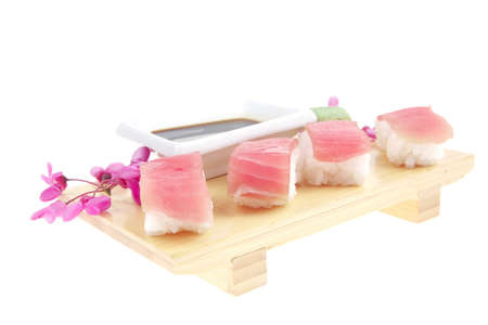 Nigiri Sushi - Set of Nigiri sushi topped with raw Tuna (maguro) . isolated over white background . on wooden board Stock Photo - 9899726