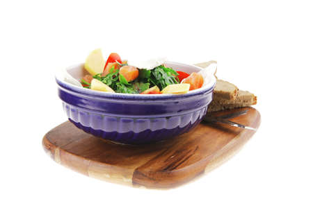 green salad with salmon and tomatoes on wood Stock Photo - 9928683