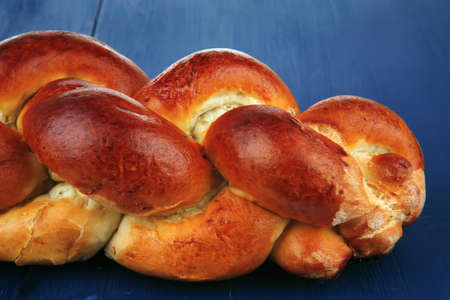 baked product : challah over blue painted wooden board photo