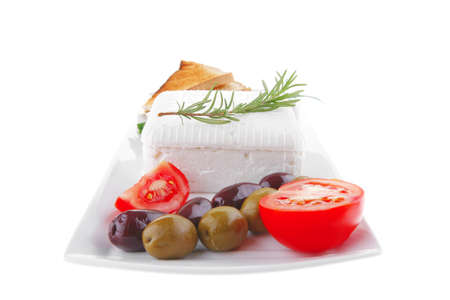 image of soft feta cube and bread toast on plate photo