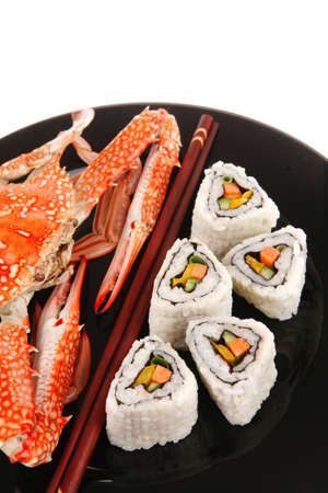 Sushi Maki Roll with Vegetables and Salmon inside . on black dish with boiled crab . Japanese Cuisine Stock Photo - 10130493