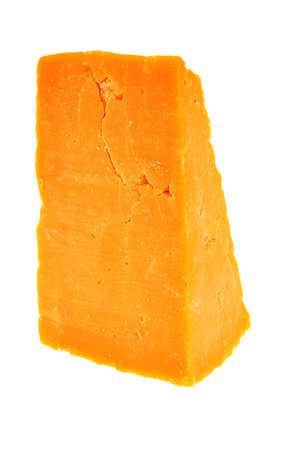 piece of cheddar cheese isolated on a white background  Banque d'images