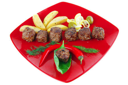grilled beef meatballs with gold baked potatoes photo
