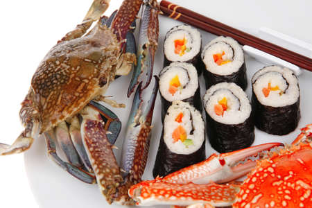 philadelphia roll: Japanese Traditional Cuisine - California Roll with Avocado and Salmon, Cream Cheese . on black dish with red and blue crabs .  Stock Photo