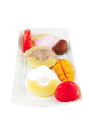 fresh tropical fruits and ice cream on white Stock Photo - 10277183