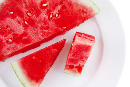 red raw watermelon pieces on white plate photo