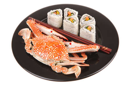 Sushi Maki Roll with Vegetables and Salmon inside . on black dish with boiled crab . Japanese Cuisine  Stock Photo - 10315458