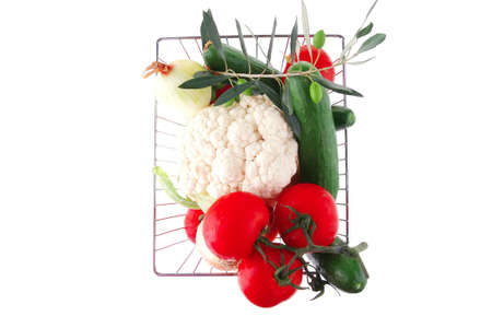 metal basket with vegetables on white background Stock Photo - 10314702
