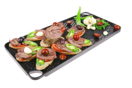 snakes on plate : tartlets with meat and vegetables isolated on white photo