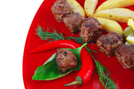 grilled meatballs with potatoes and peppers photo
