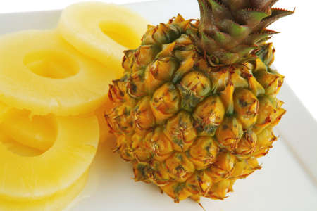 fresh raw pineapple sliced on white plate 版權商用圖片